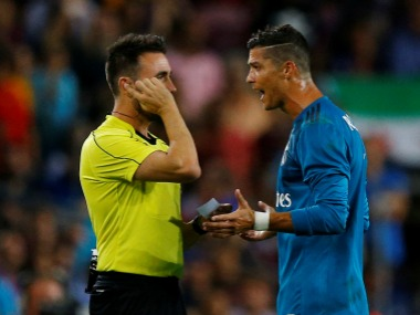 Cristiano Ronaldo was shown a second yellow for simulation in Barcelona's penalty area. Reuters