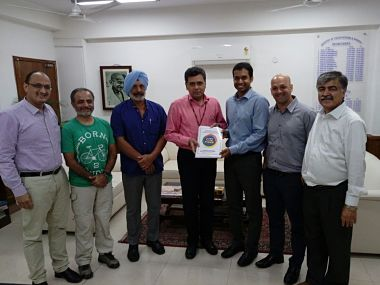 Olympic Task Force members presenting the report to Union Sports Secretary Injeti Srinivas