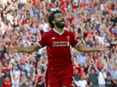 Liverpool's Mohamed Salah celebrates scoring his side's third goal of the game during their English Premier League soccer match at Anfield, Liverpool, England, Sunday Aug. 27, 2017. (Peter Byrne/PA via AP)