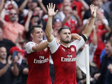 Arsenal's Sead Kolasinac, right, celebrates scoring his sides first goal during the English Community Shield soccer match between Arsenal and Chelsea at Wembley Stadium in London, Sunday, Aug. 6, 2017. (AP Photo/Kirsty Wigglesworth)