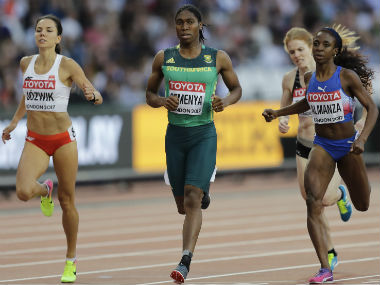 South Africa's Caster Semenya, center, leads the field to the finish line to win her heat of the women's 800 meters at the World Athletics Championships in London. AP