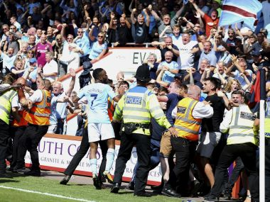 Manchester City's Raheem Sterling celebrates with the crowd after scoring his side's second goal during the Premier League soccer match between AFC Bournemouth and Manchester City at the Vitality Stadium, Bournemouth, England. Saturday Aug 26, 2017. (Steve Paston/PA via AP)
