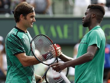 Mar 25, 2017; Miami, FL, USA; Roger Federer of Switzerland (L) shakes hands with Frances Tiafoe of the United States (R) after their match on day five of the 2017 Miami Open at Crandon Park Tennis Center. Federer won 7-6(2), 6-3. Mandatory Credit: Geoff Burke-USA TODAY Sports - RTX32PNT