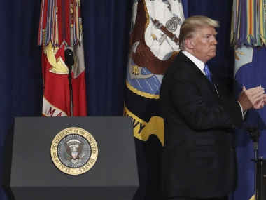 Donald Trump walks off after speaking on his Afghanistan policy. AP