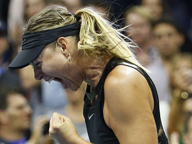 Maria Sharapova reacts after defeating Simona Halep 6-4, 4-6, 6-3 in their opening round match in the U.S. Open tennis tournament in New York, Monday, Aug. 28, 2017. (AP Photo/Kathy Willens)