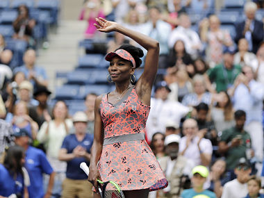 Venus Williams, of the United States, waves to spectators after beating Viktoria Kuzmova, of Slovakia, during the first round of the U.S. Open tennis tournament, Monday, Aug. 28, 2017, in New York. (AP Photo/Seth Wenig)