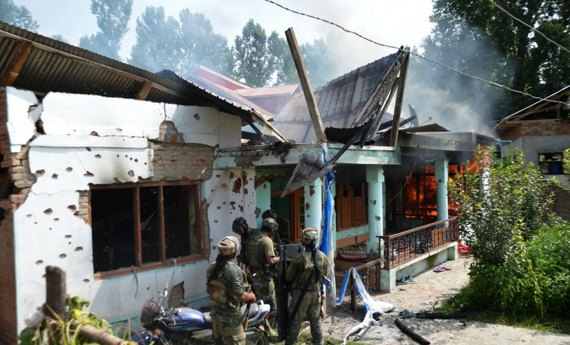The house where militant commander Abu Dujana and his associate were holed up goes up in flames. Firstpost/Suhail Bhat