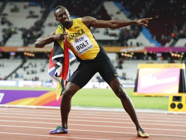 Usain Bolt of Jamaica gestures after the 100m race. Reuters
