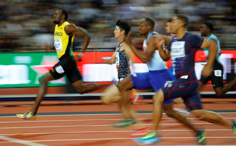 Usain Bolt of Jamaica competes in the men's 100 metres heat. He crossed the finish line first in 10.07. Reuters