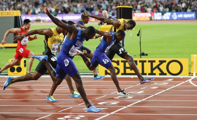 Usain Bolt of Jamaica, Justin Gatlin and Christian Coleman of the US compete in the men's 100 metres final. Reuters