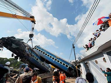 A mangled coach of the Puri-Haridwar Utkal Express train being hauled off the tracks by a crane, at the accident site in Khatauli near Muzaffarnagar on Sunday. PTI