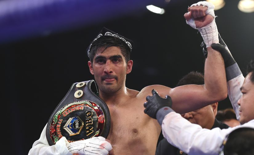 Indian boxer and WBO Asia-Pacific Super Middleweight champion Vijender Singh celebrates after winning the double title bout against China's Zulpikar Maimaitiali at the National Sports Complex of India (NSCI) Dome in Mumbai. AFP