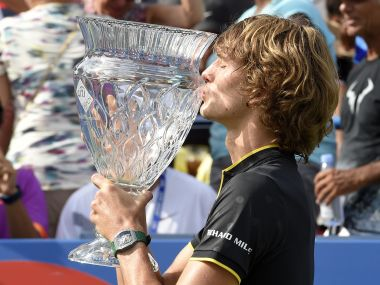 Alexander Zverev kisses the trophy after he defeated Kevin Anderson to win the Citi Open. AP