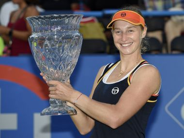 Ekaterina Makarova poses with the trophy after her victory over Julia Goerges. AP
