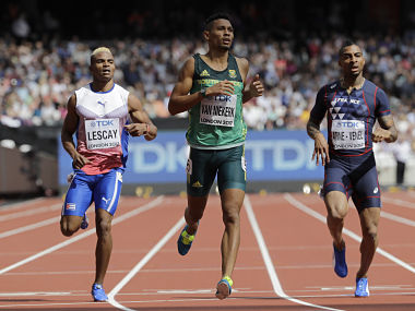 South Africa's Wayde Van Niekerk eases down to win the Men's 400m first round heat. AP