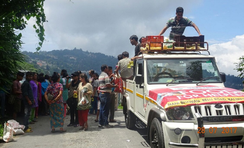 Relief goods being distributed from a pick-up truck in Darjeeling. Firstpost/Upendra Mani Pradhan