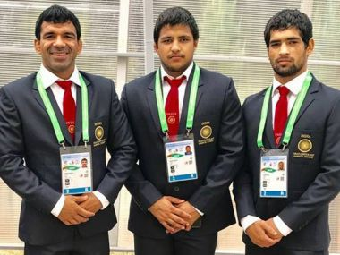 Freestyle wrestling winners Virender Singh (74kg, Gold), Ajay Kumar (65kg, Bronze) and Sumit Dahiya (97kg, Bronze). Image Courtesy: Twitter/@Media_SAI