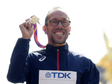 Yohann Diniz of France poses with his gold medal. Reuters