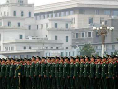 Chinese paramilitary policemen stand in formation on Tiananmen Square after attending the ceremony on Tuesday. AP