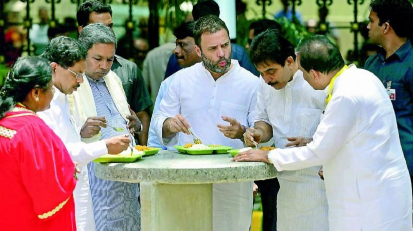 Congress leaders, led by vice-president Rahul Gandhi, seen discussing idli attack on RSS. PTI