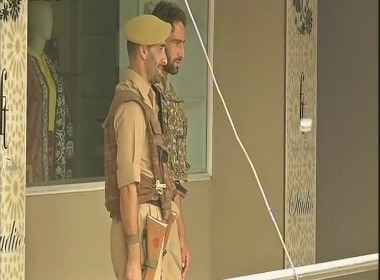 Police outside Alkhudam tours and travels in Srinagar. Twitter @ANI