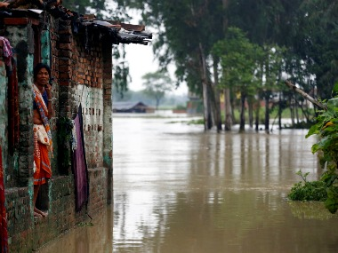 A woman looks out from her house at a flood affected area in Janakpur, Nepal. Reuters