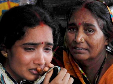 Relatives mourn after the death of children in the state-run Baba Raghav Das Medical College in Gorakhpur on Friday. PTI