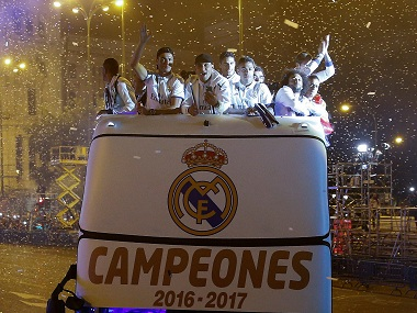 Real Madrid players celebrating their title-winning run at the end of last season. Reuters
