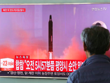 A man watches a TV screen showing a file footage of North Korea's missile launch, at the Seoul Railway Station in Seoul, South Korea, Tuesday, AP