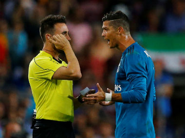 Cristiano Ronaldo argues with the referee after being shown the red card against Barcelona. Reuters