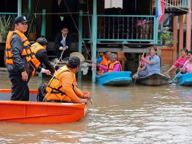 Thailand's Prime Minister Prayuth Chan-ocha speaks to flood-affected residents. Reuters