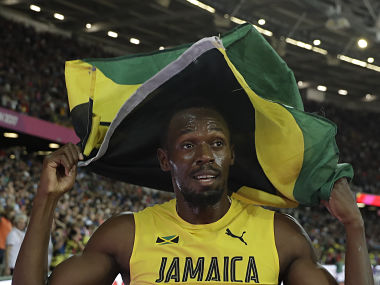 Jamaica's Usain Bolt celebrates with his national flag after placing third in the men's 100m final on Saturday. AP