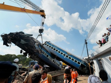 A mangled coach of the Puri-Haridwar Utkal Express train being hauled off the tracks by a crane, at the accident site in Khatauli near Muzaffarnagar on Sunday