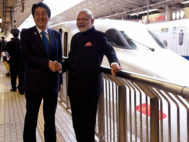 A file image of Prime Minister Narendra Modi with his  Japanese counterpart Shinzo Abe. PTI