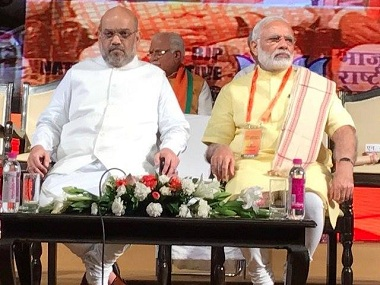 Amit Shah with Narendra Modi at the BJP National Executive meet. Facebook@BJP4India