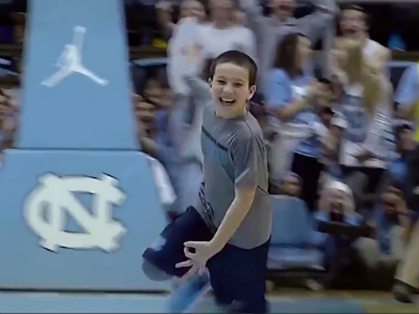 11-year-old Asher Lucas celebrates after scoring three half-court shots. Screengrab