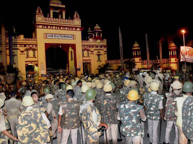 Heavy deployment of police personnel at Banaras Hindu University where students were holding a protest in Varanasi, late Saturday night. PTI