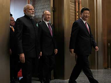 Chinese President Xi Jinping, leads Russian President Vladimir Putin and Indian Prime Minister Narendra Modi to a plenary session of BRICS Summit, in Xiamen, China. AP