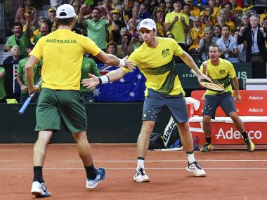 Australia's captain Lleyton Hewitt, right, cheers as players John Peers and Jordan Thompson react after winning a game. AP
