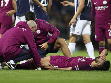 Manchester City's Ilkay Gundogan lays injured during the League Cup Third Round soccer match, West Bromwich Albion versus Manchester City at The Hawthorns, West Bromwich, England, Wednesday Sept. 20, 2017. (David Davies/PA via AP)
