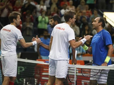 Canada's Daniel Nestor and Vasek Pospisil shake hands with India's Rohan Bopanna and Purav Raja after their win. AP