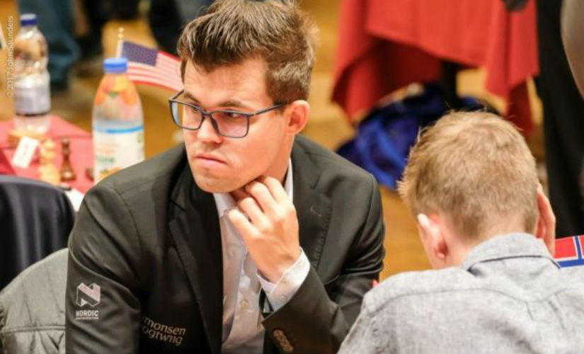 When you're the world champion, you don't even have to look at the board to win! Magnus Carlsen at the event. John Saunders