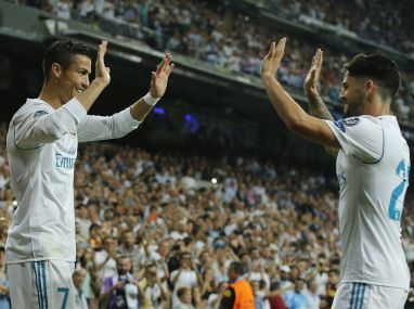 Cristiano Ronaldo, celebrates scoring with teammate Isco during their Champions League match. AP