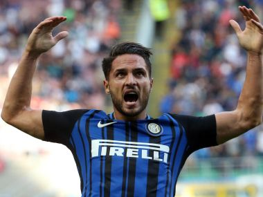 Inter Milan's Danilo D'Ambrosio, right, celebrates after scoring during a Serie A soccer match between Inter Milan and Genoa, at Milan's San siro Stadium, northern Italy, Sunday, Sept. 24, 2017. (Matteo Bazzi/ANSA via AP)