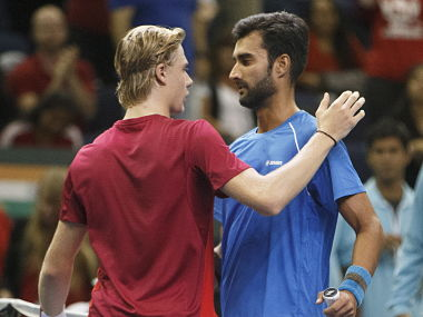 Canada's Denis Shapovalov, left, and India's Yuki Bhambri after their match in Davis Cup. AP