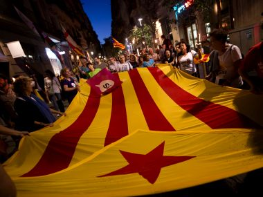 "People carrying ""esteladas"" or independence flag in Barcelona. AP"