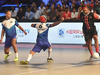 Delhi Dragons player Ronaldinho in action against Krystal Mumbai Warriors Ryan Gifts. PTI