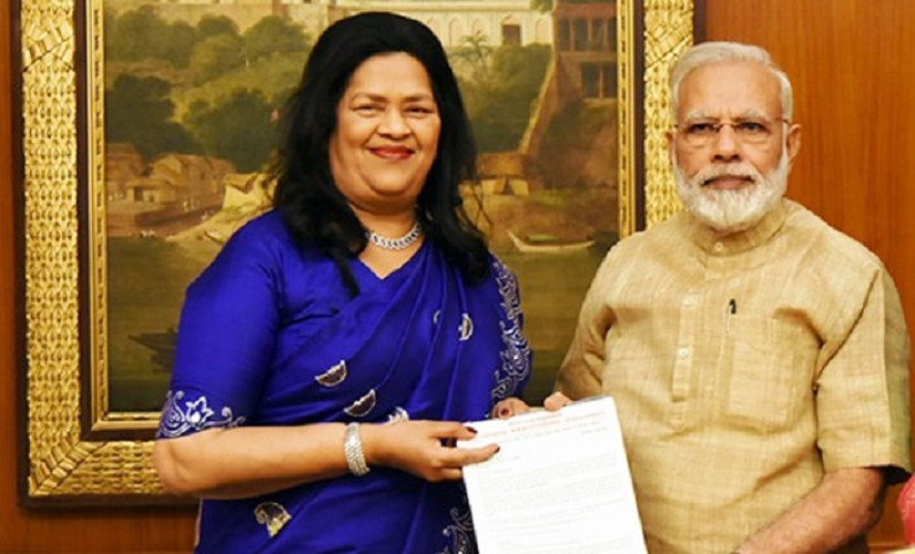 File image of Grace Pinto with Prime Minister Narendra Modi. Image courtesy: Ryaninternational.org