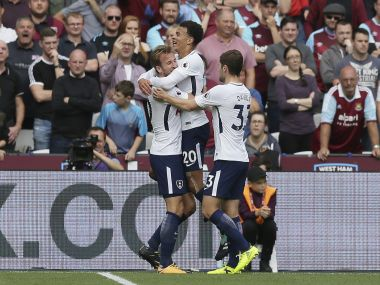 Tottenham's Harry Kane, left, celebrates after scoring his team's first goal, with Tottenham's Dele Alli, centre, and Tottenham's Ben Davies during the English Premier League soccer match between West Ham United and Tottenham Hotspur at the London Stadium in London, Saturday Sept. 23, 2017. (AP Photo/Tim Ireland)