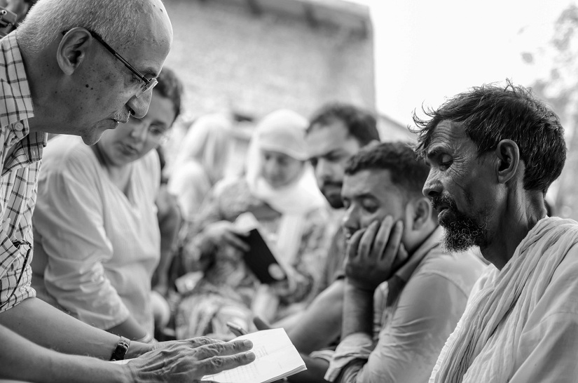 Harsh Mander and Karwan team reading legal papers of a victim's family in Nuh, Mewat, Haryana